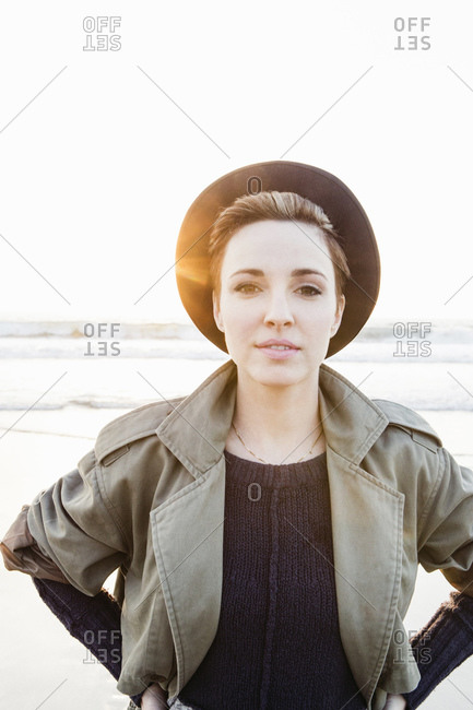 Hip young woman in sunlight on winter beach