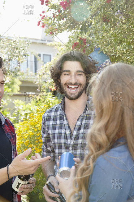 Friends laugh together at a backyard party