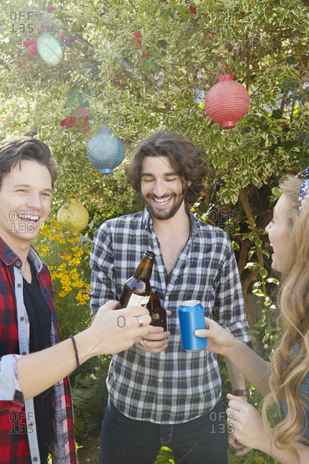 Friends toast together at a backyard party