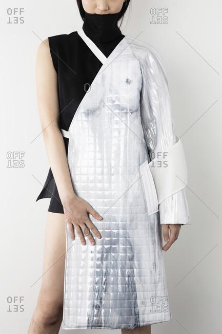 Woman wearing avant-garde vinyl fashion