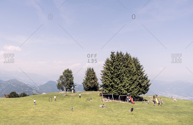 People at playground on top of Monte Poieto, Italy