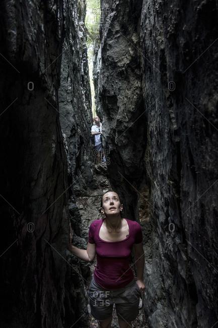 Monte Poieto, Italy - July 5, 2015: Woman exploring gorge on Monte Poieto, Italy