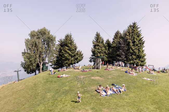 Monte Poieto, Italy - July 5, 2015: Crowds sunbathing on top of Monte Poieto, Italy