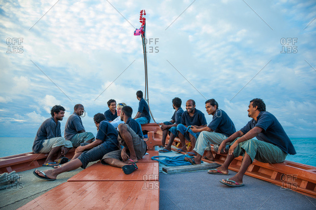 South Ari Atoll, Maldives - December 30, 2009: Several Maldivian men on a boat