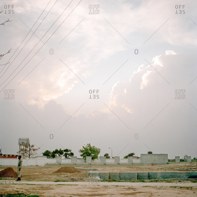 Lahore, Pakistan - March 1, 2009: Guard standing near construction site in Lahore