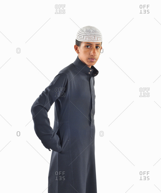 Dhahran, Eastern Province, Saudi Arabia - December 2, 2009: Portrait of Saudi teen male in traditional clothing