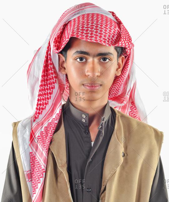 Dhahran, Eastern Province, Saudi Arabia - December 3, 2009: Saudi Arabian teen male in traditional dress