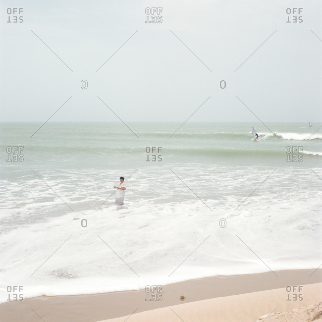 Aseela, Oman - August 5, 2011: Man standing in sea in Aseela