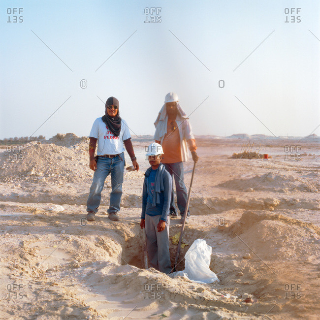 Dhahran, Eastern Province, Saudi Arabia - April 1, 2010: Three construction workers in Saudi Arabia