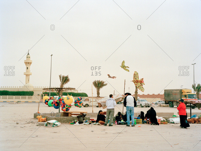 Nariyah, Eastern Province, Saudi Arabia - January 12, 2012: Customers and vendors in Saudi Arabian outdoor market