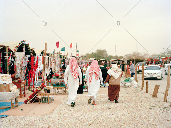 Nariyah, Eastern Province, Saudi Arabia - January 12, 2012: Three men in traditional clothing in Saudi Arabian market