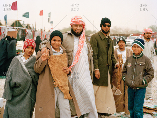 Nariyah, Eastern Province, Saudi Arabia - January 12, 2012: Group of men and boys in Saudi Arabian market