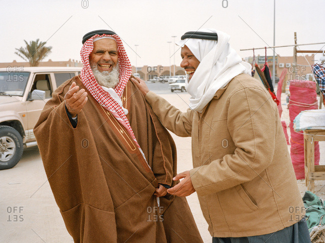 Nariyah, Eastern Province, Saudi Arabia - January 12, 2012: Two older men laughing in Saudi Arabian market