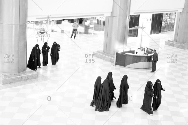 Riyadh, Saudi Arabia - January 2, 2013: Women in abayas shopping in Saudi Arabian mall