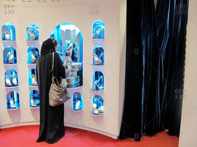 Riyadh, Saudi Arabia - September 13, 2012: Woman browsing shoes in Saudi Arabian mall