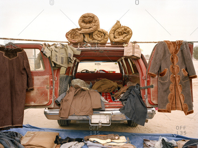 Clothing and textiles for sale from a car trunk