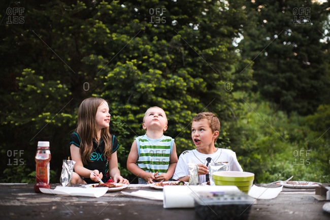 Children eating at a campground picnic table