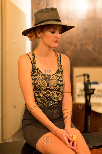 Portrait of a beautiful young woman wearing a hat