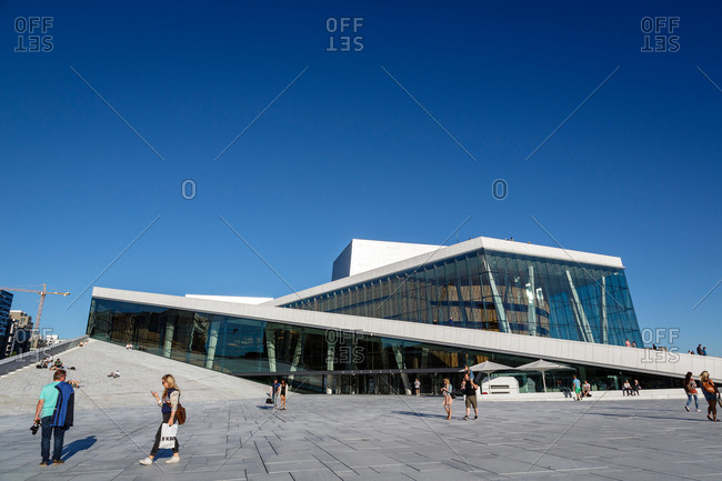 Oslo, Norway - June 27, 2015: People stroll outside the National Opera House, Oslo, Norway