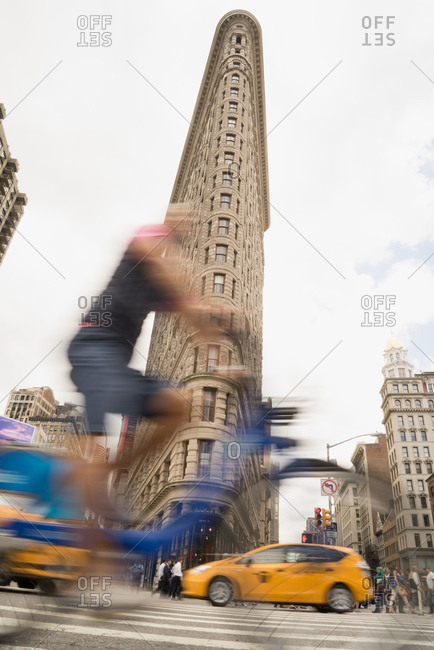June 29, 2015: A bike share rider cycles past the Flatiron Building, New York City