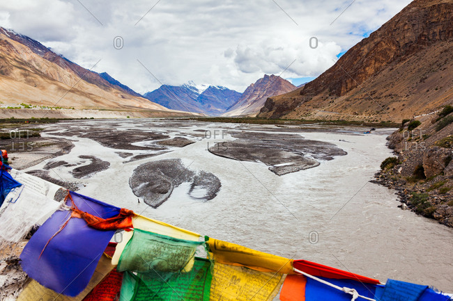 Rafters and prayer flags on Spiti river in Himachal Pradesh, India