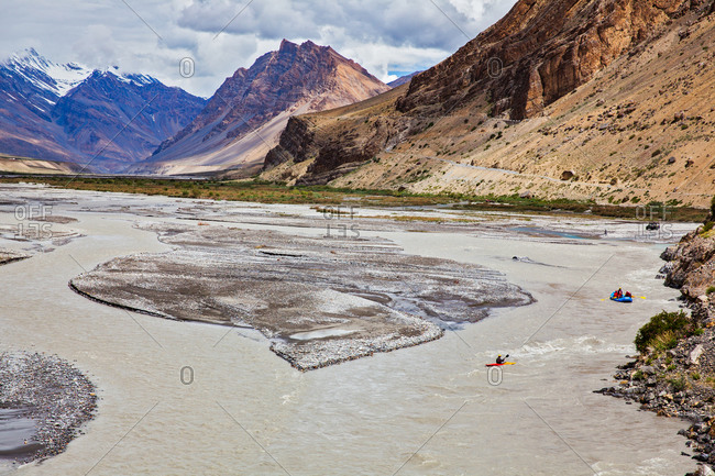 Rafters heading down Spiti river in Himachal Pradesh, India