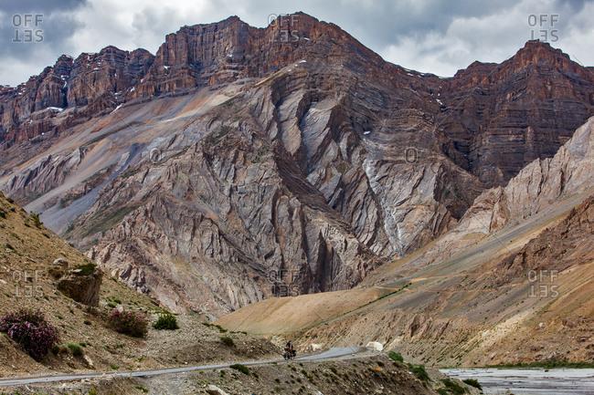 Man on a touring bike traveling to Spiti in Himachal Pradesh