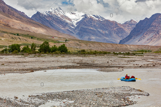 Rafters on calm water in Spiti river, Himachal Pradesh, India