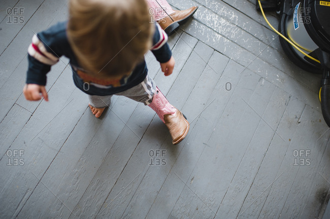 Little boy trying on a cowboy boot