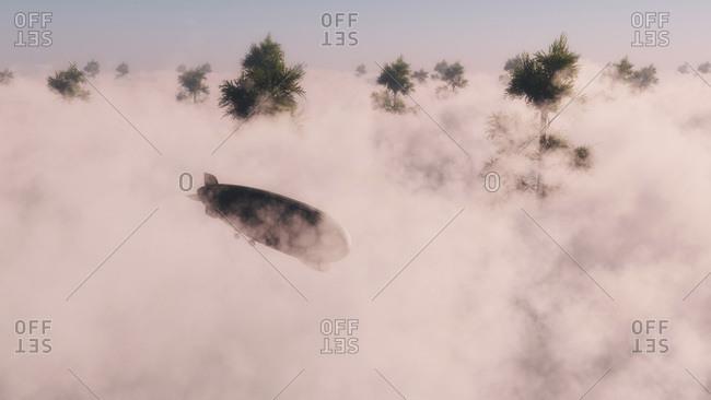 Blimp of airship flying through low cloud