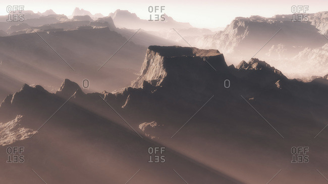 Sunrise over a mountainous landscape in the mist