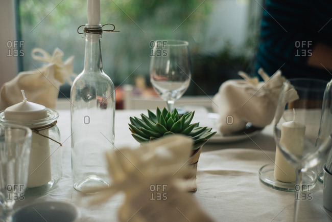 Plants and candles decorate a party table