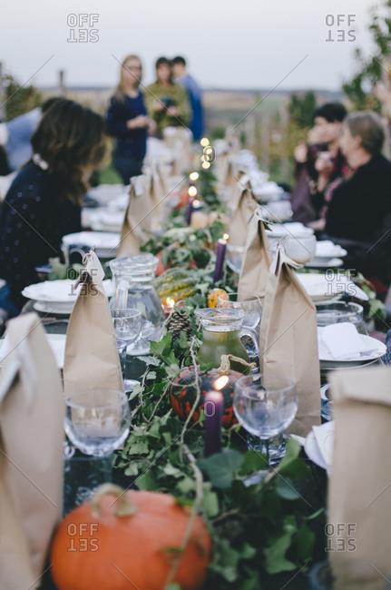 An outdoor dinner party in autumn