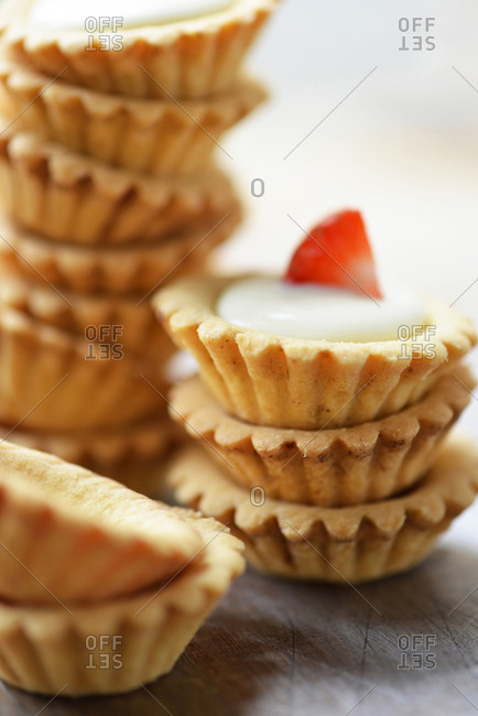 Stacks of pastry tarts filled with cream