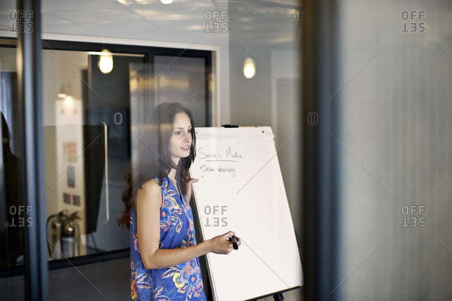 Woman in office leading a meeting