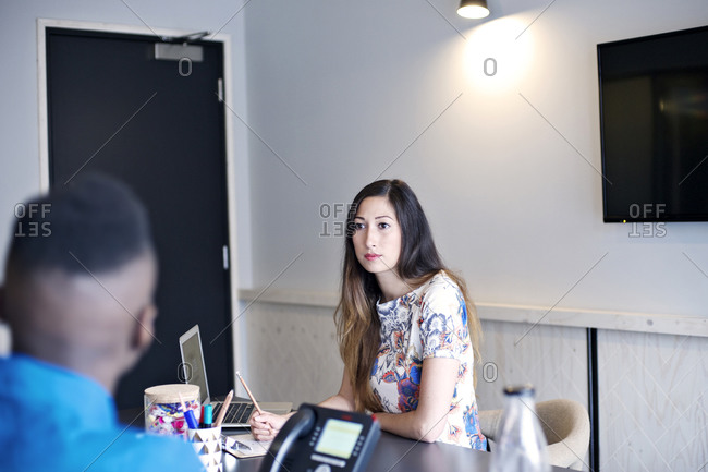 Woman listening attentively to colleague
