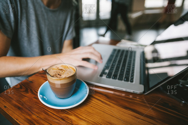 Man at a laptop with coffee