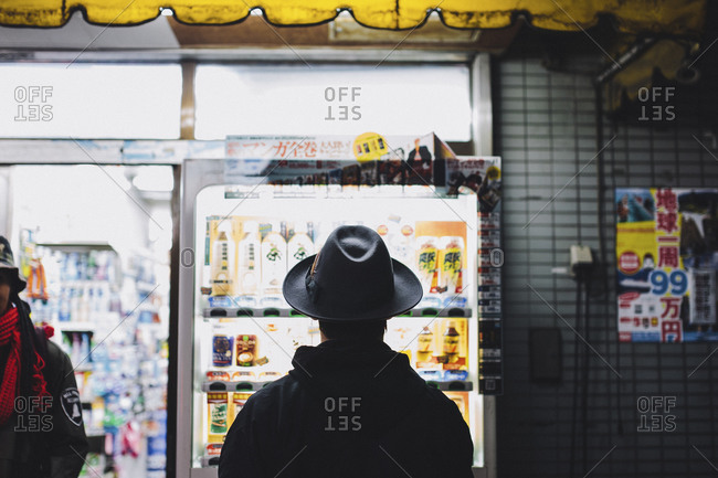 Man standing in front of a drink machine