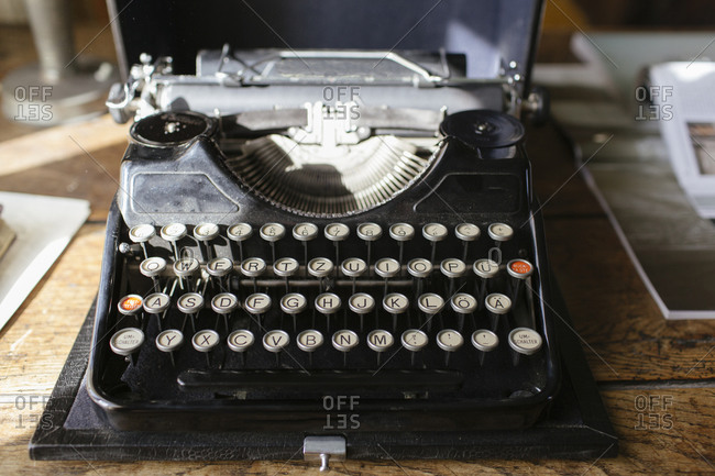 Old fashioned typewriter on a wooden table