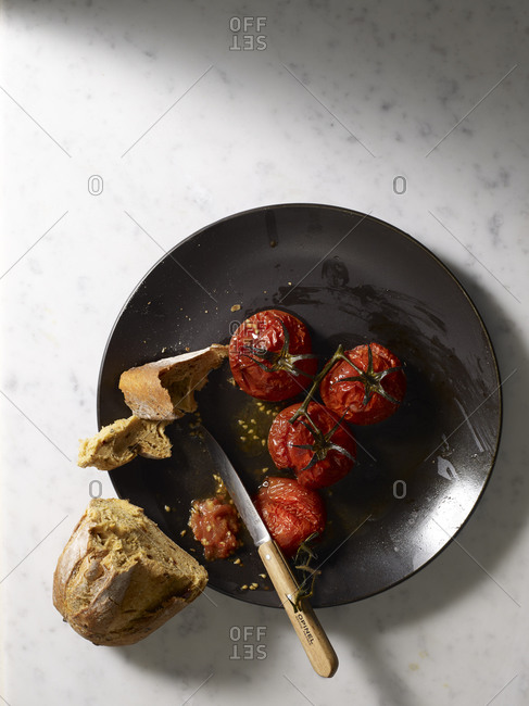 Bread on plate with roasted tomatoes