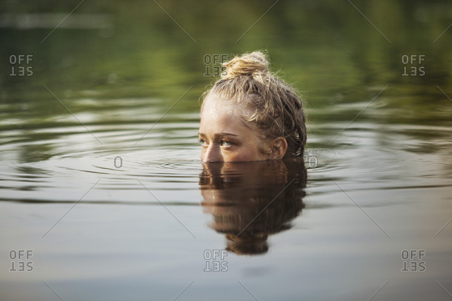 A young woman submerged in a lake