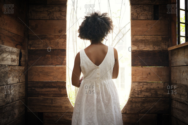 Girl looking out a tree house window
