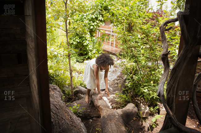 Girl climbing a backyard tree