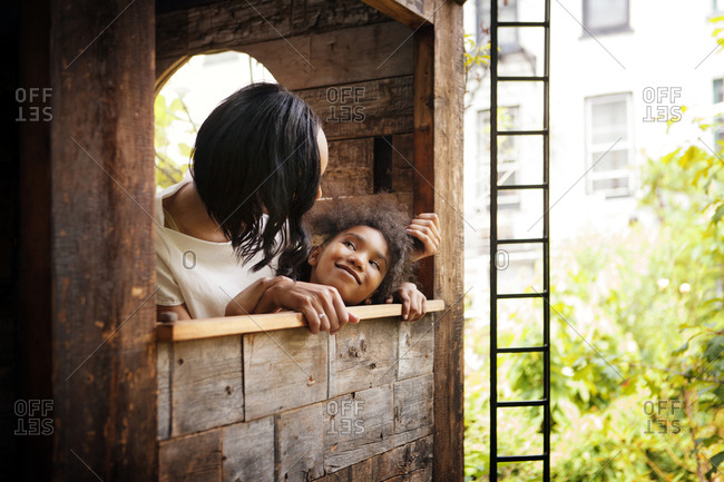 Mother and daughter in a tree house