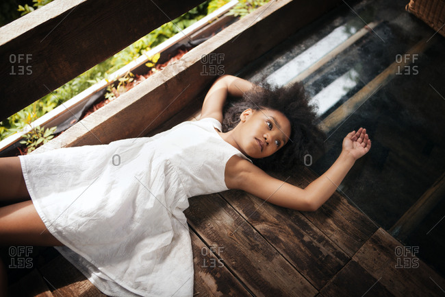 Girl lying down in a tree house