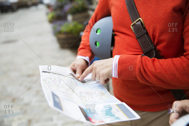 A casual cyclist looks at a map