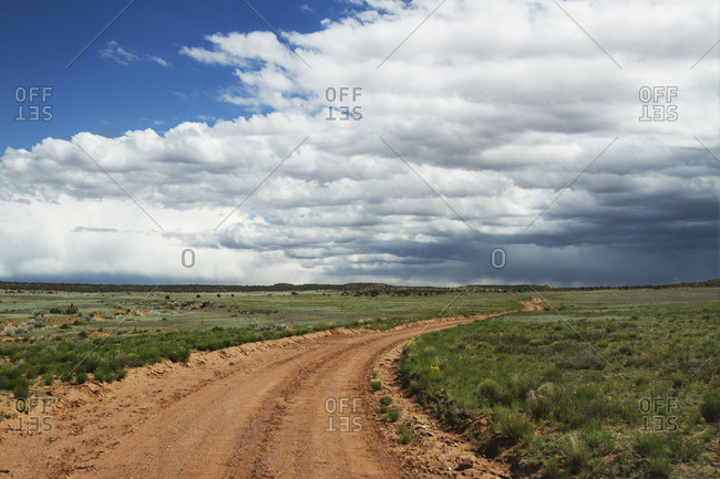 Dirt road and changing weather over a Texas landscape
