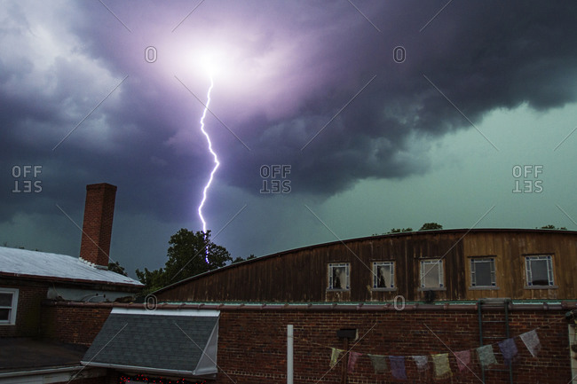Lightning bolt over rooftops