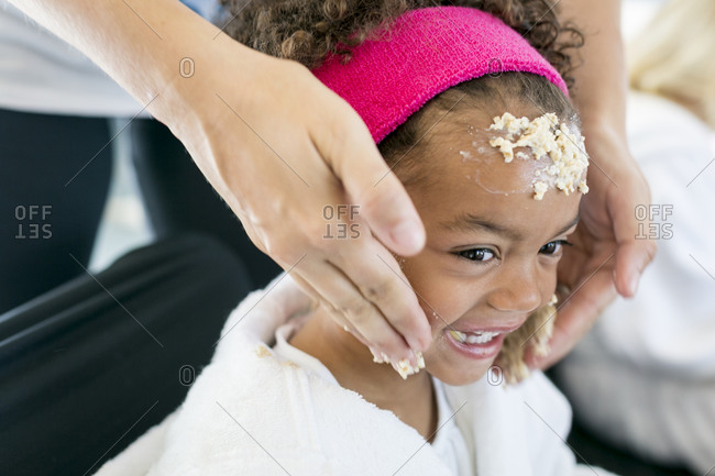 Santa Fe, New Mexico - June 24, 2015: Little girl getting oatmeal scrub at a spa party designed by Parties for Peanuts