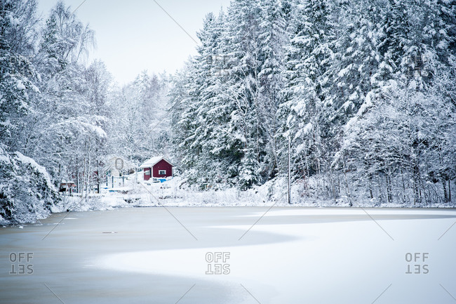 Cabin on a frozen lake